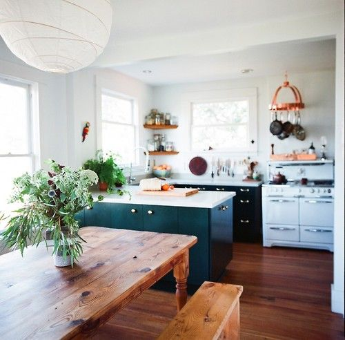 Open plan kitchen dinner, wooden farm house table