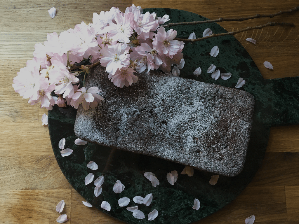 Vegan Ginger Cake on marble with Pink Blossom