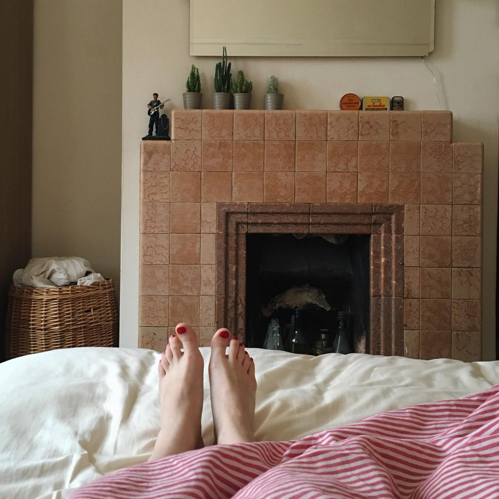 Farewell Number 35, View of Feet in Bed, Striped Bed Sheets,