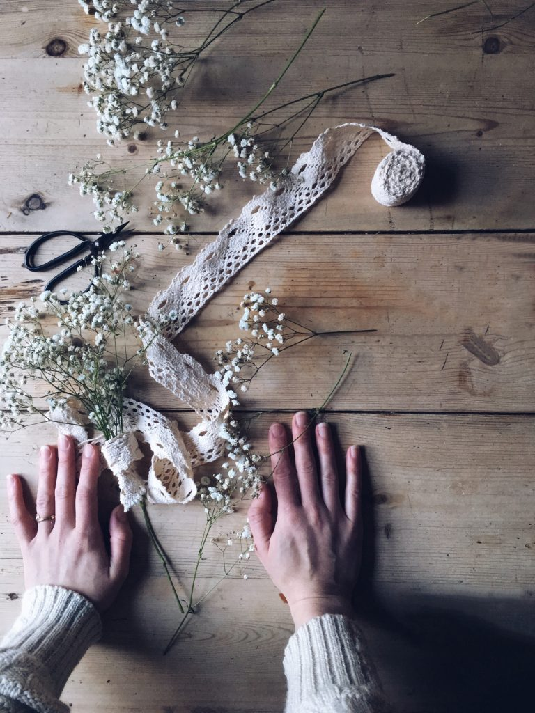 bunch of gypsophila baby's breath lace ribbon hands